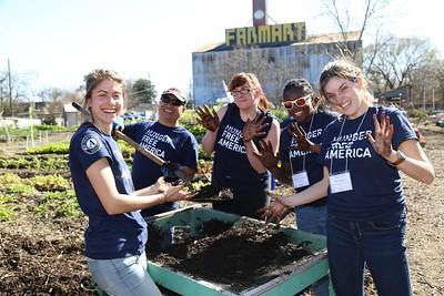 AmeriCorps members serving in community garden