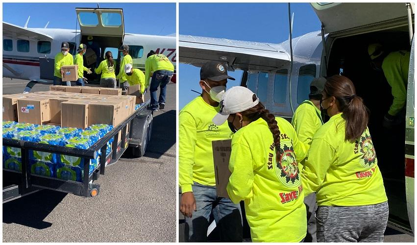 Chinle Chapter members load water into plane to dispense to community